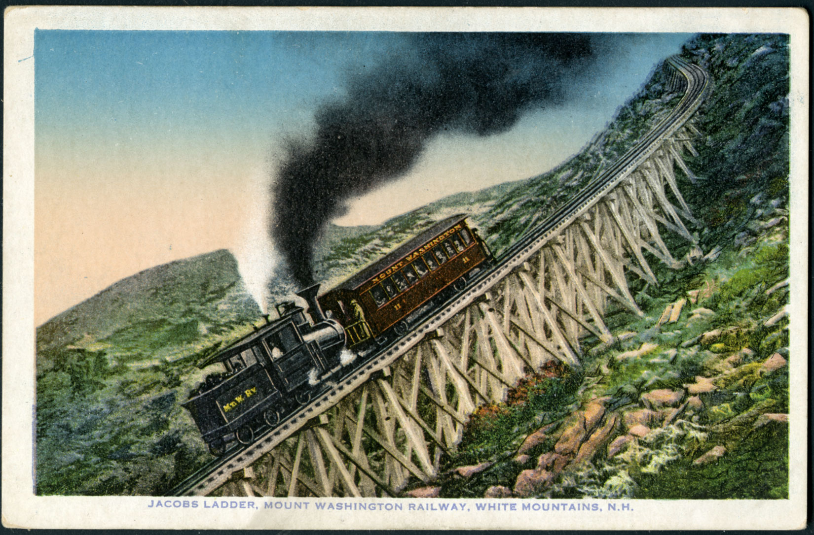 A color postcard of a train with one passenger car has a caption reading