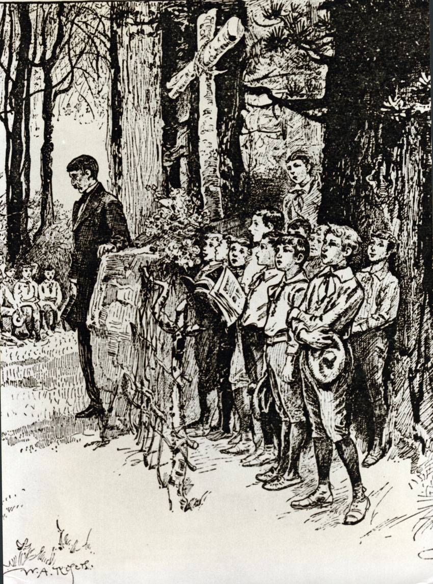A black and white drawing shows people in a woodland scene. There are large trees, showing only their trunks. There is a large cross made from birch tree branches in the center of the drawing. About ten boys are standing under the cross facing left; they have books and their mouths open. They are wearing uniforms with shorts and button down shirts with small ties. A man in a dark suit is standing next to a pulpit made of rock; he is standing solemnly. In the background to the left, seated boys can be seen.